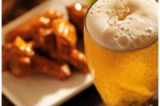 Glass of beer with chicken wings